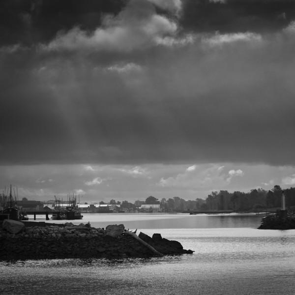Rays of sun breaking through the morning cloud at Steveston.