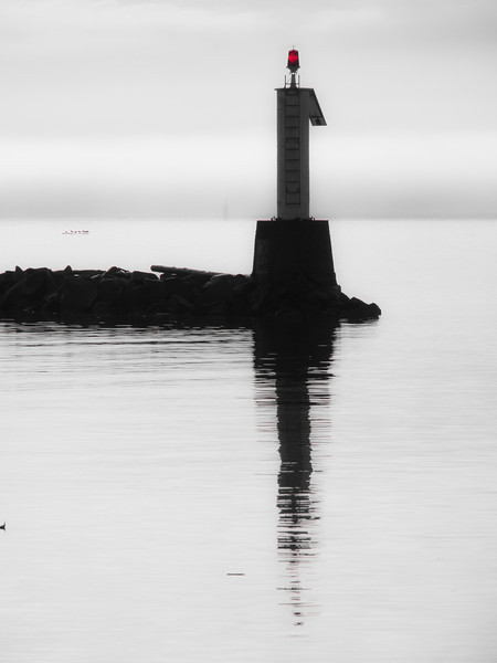 Silhouette of the light beacon at the entrance to Steveston Harbour.
