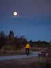 Bicyclist enjoys a moonlight ride through Garry Point Park on a full moon. No werewolves were spotted and I'm sure he got home safely...or did he?