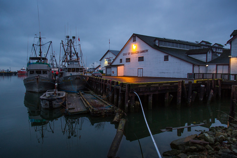 Boats tied up at the Gulf of Georgia Cannery in Steveston on a dark and dreary day.