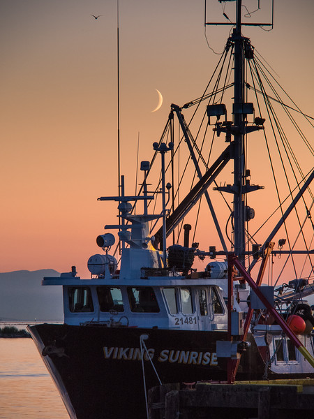 "The ""Viking Sunrise"" at sunset and moonset in Steveston."