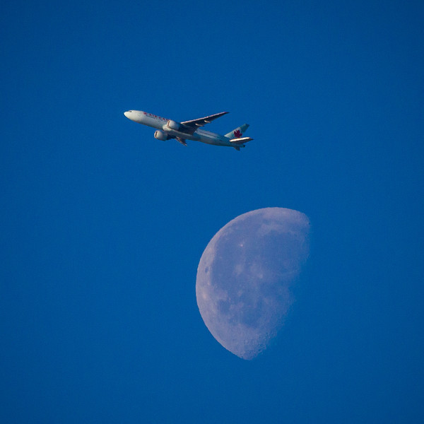 An Air Canada jet looks like it's flying over the moon.