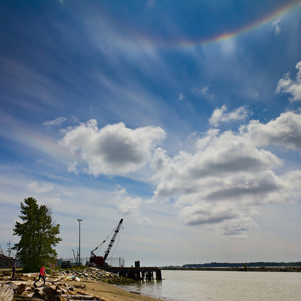 Upside down rainbow or circumzenithal arc appears over the Frazer river at Garry Point Park.