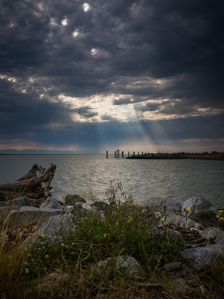 Sun breaking through the clouds at Garry Point Park in Richmond, BC.