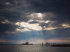 "Sun breaking through the clouds onto the ""Fraser Titan"" at Garry Point Park in Richmond, BC."