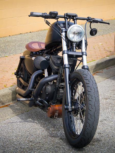 Custom Harley Davidson parked beside the Steveston Hotel.
