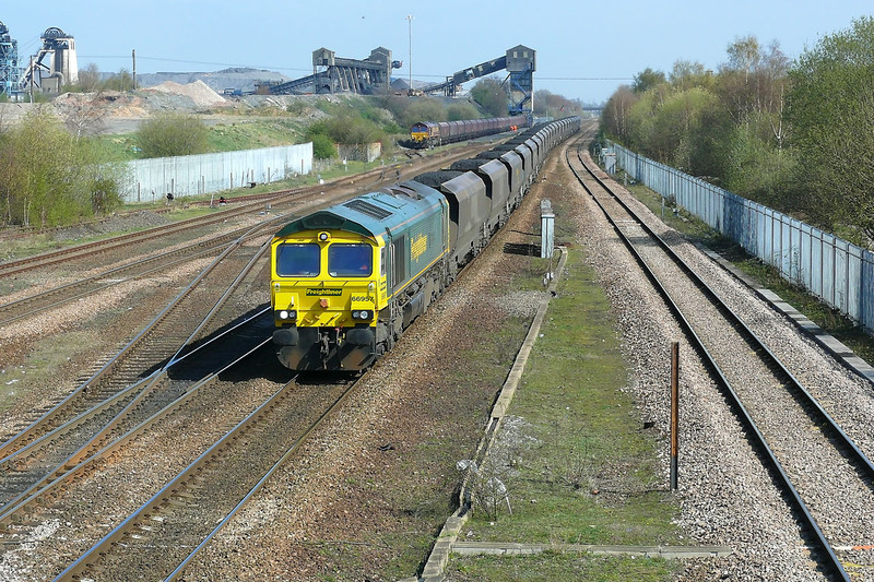 Freightliner Heavy Haul's 66957 passes DB Shenker 66015 in Hatfield Main Colliery as  it waits it path on the mainline 66957 working 6Y13 1145 Immingham H.I.T. - Ferrybridge 'C' Power Station coal train.