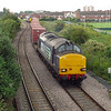 37611 & 606 Are seen approaching Southcoates Lane bridge with 6Z30 in dire light.