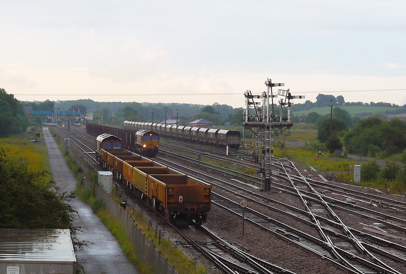 66014 is seen passing 66105 that is at the head of 6T29 2030 Departure from Immingham Ore Terminal to Scunthorpe Trent Yard Iron Ore working