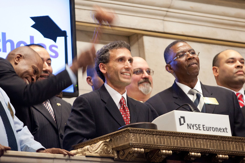 NEW YORK, NY - DECEMBER 21:  Plinio Ayala, President and CEO of Per Scholas rings the Closing Bell at the New York Stock Exchange on December 21, 2011 in New York City. (Photo by Ben Hider/NYSE Euronext)<br /> <br /> We should use this photo in the partner book. All of the students pictured are veterans.