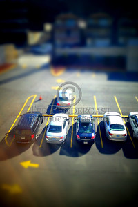 Little itty bitty cars in the little itty bitty parking lot