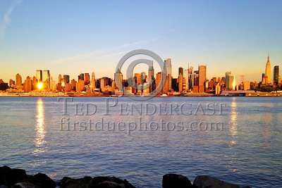 Looking across the Hudson River from Weehawken NJ as the sun sets on Manhattan