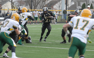 Glenbard North's Justin Jackson fields the ball during their playoff game against Stevenson Saturday November 3, 2012. Glenbard North defeated Stevenson 23/14.   Staff photo by Erica Benson