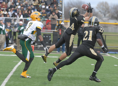 Glenbard North's Ryan Storto intercepts the ball during their playoff game against Stevenson Saturday November 3, 2012. Glenbard North defeated Stevenson 23/14.   Staff photo by Erica Benson
