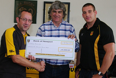 Will Godfrey accepts a cheque for £6K from FoNR's Nick Jackson to help fund a coaching position for Rhys Jenkins at Newport High School.
