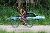 BRASIL 2012-03-25 REUNIAO NO BANHADO COM MORADORES E REPRESENTANTES DO BID - BANCO INTERAMERICANO DE DESENVOLVIMENTO PARA ACORDO AMIGAVEL E DEFINICAO DAS 285 FAMILIAS QUE MORAM NO LOCAL E QUE A PRFEITURA QUER REMOVER PARA A PASSAGEM DE UMA AVENIDA E CRIACAO DE UM PARQUE NO CENTRO DA CIDADE. O DEFENSOR PUBLICO DR JAIRO SALVADOR ESTEVE NO LOCAL E ANUNCIOU TAMBEM QUE A DEFENSORIA PUBLICA GANHOU RECENTEMENTE UMA ACAO MOVIDA POR 3 MORADORES CONTRA A PREFEITURA PELA NAO RETIRADA DE ENTULHOS DAS CASAS JA DEMOLIDAS PELA PREFEITURA. A MULTA E DE R$ 1MIL POR DIA E DEVE SER REVERTIDA A FAVOR DOS AUTORES DA ACAO. / ciclista. / Brasilien: Armensiedlung. Auto. Rost. Entsorgung. © Lucas Lacaz Ruiz/LATINPHOTO.org