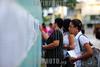 """Brasil 2012-04-15 A Prefeitura de Sao Jose dos Campos realiza neste domingo (15) mais um dia de provas do concurso publico. Serao 17 locais espalhados em varios pontos da cidade. O candidato devera consultar onde fará a prova no site da Vunesp ( <a href=""""http://www.vunesp.com.br"""">http://www.vunesp.com.br</a>) ou da Prefeitura ( <a href=""""http://www.sjc.sp.gov.br"""">http://www.sjc.sp.gov.br</a>). Na foto candidatos em frente aos dois locais de provas da UNIVAP. / Brasilien: Befragung. © Lucas Lacaz Ruiz/LATINPHOTO.org"""