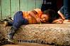 ECUADOR , Pueblos indigenas de Ecuador . Pueblo originario Shuar, vive en la selva del oriente ecuatoriano. Botas de goma . / Shuar people - indigenous people of Ecuador . They are members of the Jivaroan peoples, who are Amazonian tribes living at the headwaters of the Maranon River . / Ekuador , Indigenas vom Stamm der Shuar . Indigenes Volk . Indigenas . Gummistiefel . © Loydi Maffei Santiago/LATINPHOTO.org