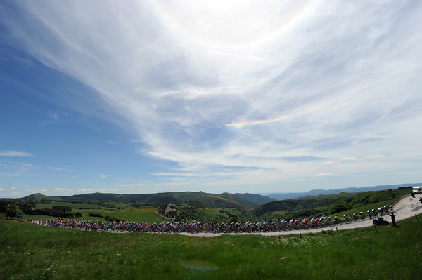 The peloton finds some delight along the heights of the Ardeche mountains...