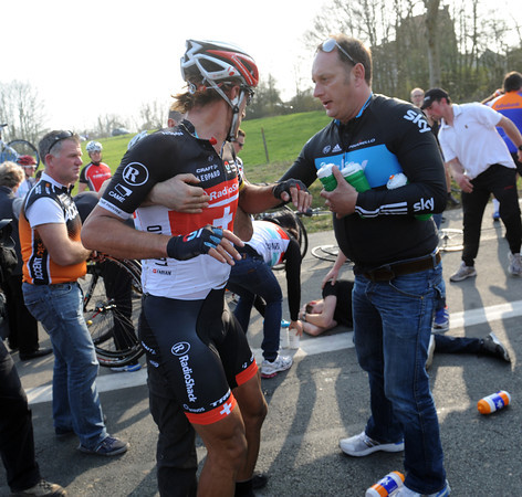 Disaster strikes for Cancellara - he's been brought down by a crash involving a Shack team helper after the Oude Kwaremont..!