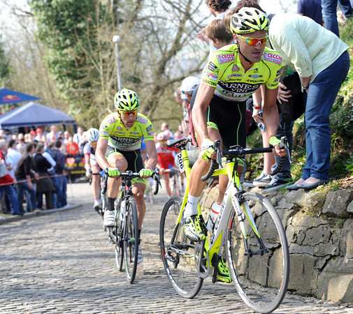 Kevin Hulsmans leads the escape on to the Muur van Geraardsbergen with a four minute lead at 104-kilometres...