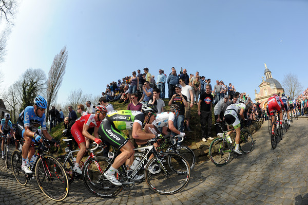 The peloton climbs the sacred Muur van Geraardsbergen that will not feature in next weekend's Tour of Flanders...