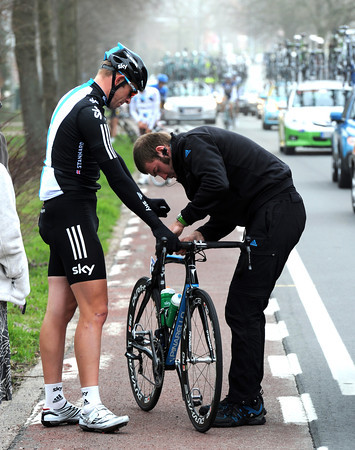 Ian Stannard gives Sky's mechanic his first task of the day...