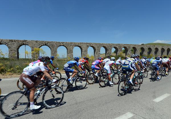 The peloton passes a Roman aqueduct...near Rome...