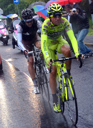 Matteo Rabottini is leading a two-man escape away in the pouring rain...