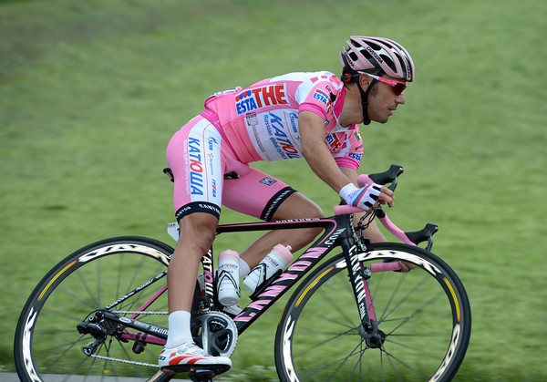 Joachim Rodriguez descends the first hill in a peloton racing flat-out in pursuit of another escape...