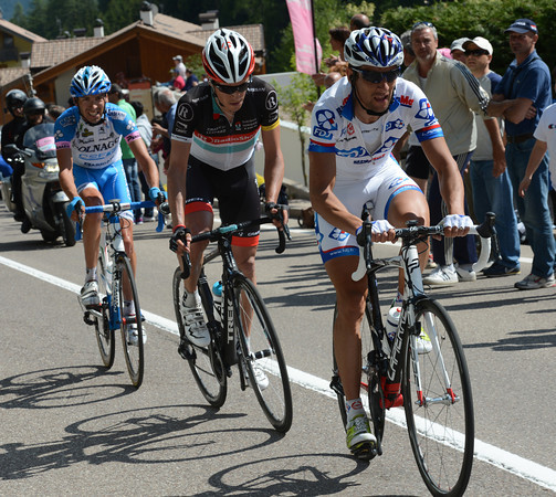 Sandy Casar, Thomas Rohregger and Pirazzi are out in front on the first ascent of Alpe di Pampeago...