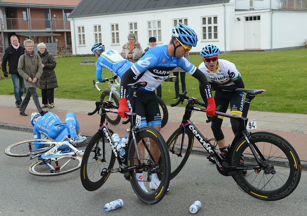 Navardauskas and Bauer are two Garmin riders caught out - but everyone gets going again...