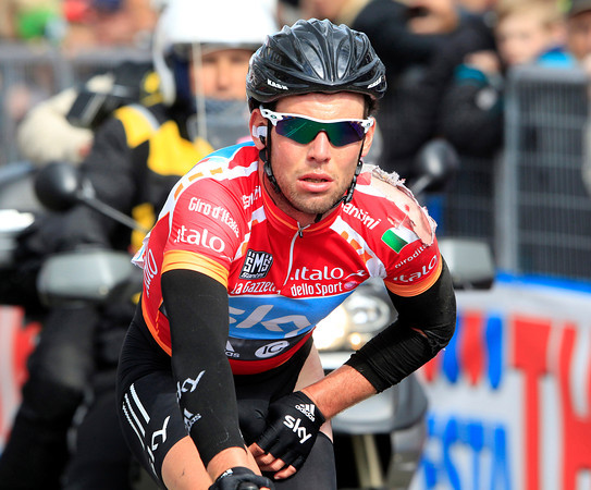 A battered Mark Cavendish finishes the stage - Taylor Phinney retains his race-lead despite crossing the line in an ambulance..!