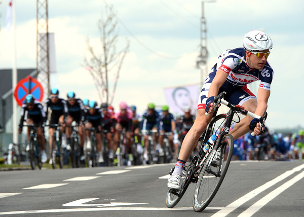 Denmark's Lars Bak makes his expected attack with two laps to go...