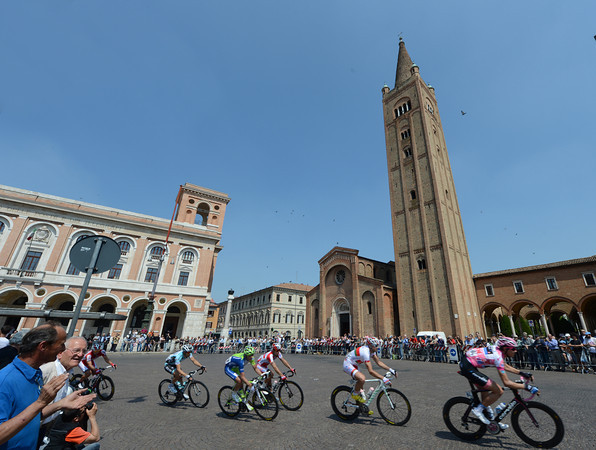 The pink jersey is near the front as the peloton speeds through Forli, about halfway through the stage...