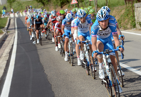 Colnago IMOX start to wind up the pace as the final climb begins...