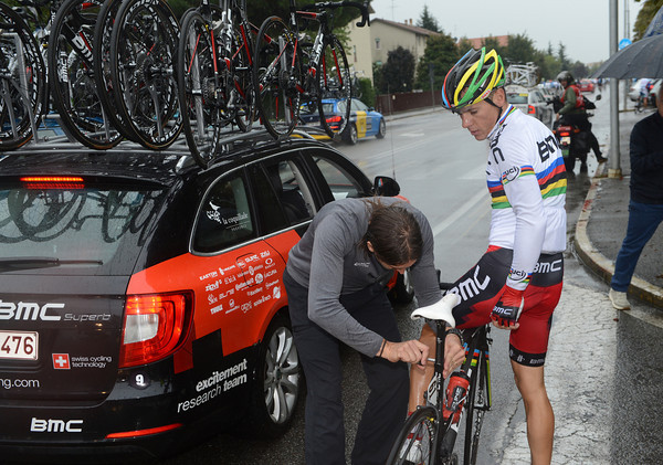 Gilbert's new-look BMC bike needs fixing too - but there's no stopping the deluge of water...