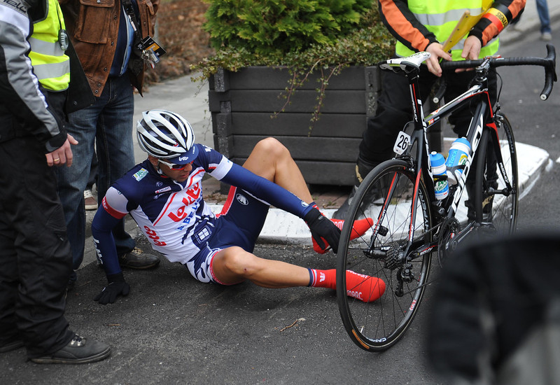 Jens Debuscheere's day starts badly after crashing into a flower-box in the nutralized zone...