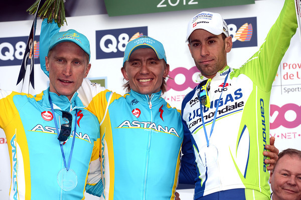 Maxim Iglinsky celebrates an extraordinary victory, with Vincenzo Nibali and Enrico Gasparotto...