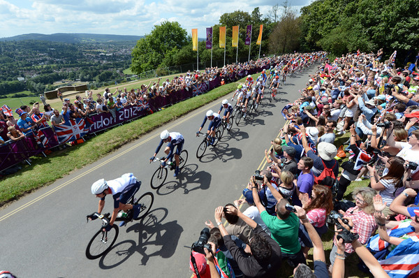 Team GB pass Box Hill, with views south over Surrey, cheered on by a huge and very patriotic crowd..!