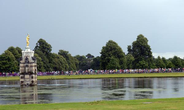 The peloton passes Diana's Fountain in Bushy Park...