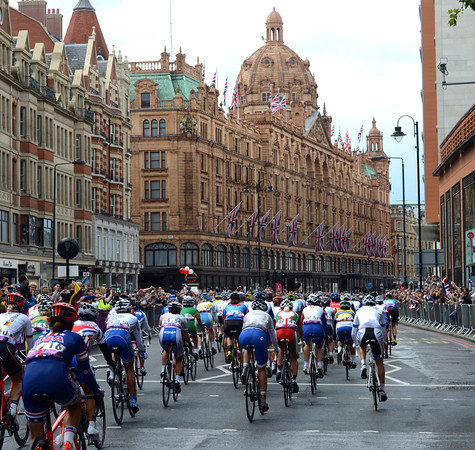 The small peloton passes Harrods before the real racing starts...