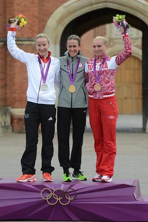 Kristin Armstrong celebrates on the podium with Judith Arndt and Olga Zabelinskaya