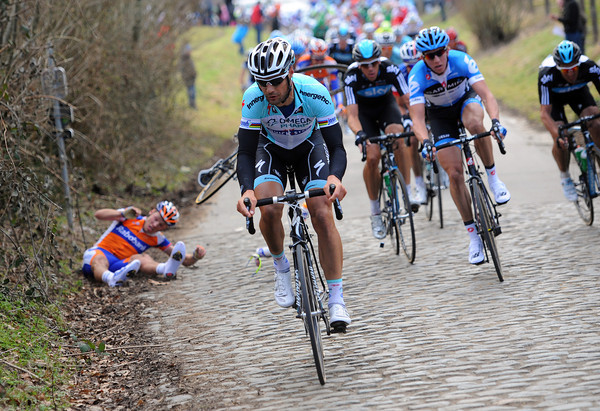 Tom Boonen appplies the pressure on the Taaienberg as Lars Boom crashes out...