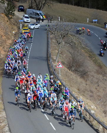 The peloton is splitting up on the penultimate ascent - but it's more because of the cold than the gradient..!