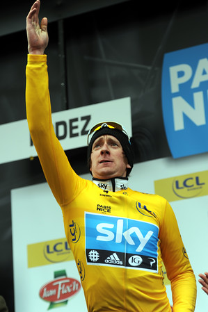 Bradley Wiggins throws his flowers into the crowd on the eve of the race's most difficult road stage...