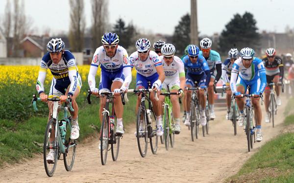 Lindeman is still leading the escape near Famars - but a huge crash has split the peloton's chase...