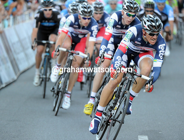 Into the final lap, and Adam Hansen leads Lotto into pole position in this so-fast peloton...