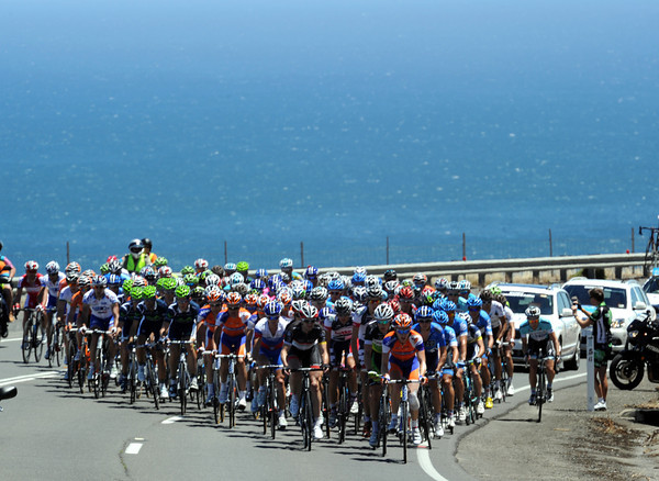 The peloton climbs above a windblown Sellick's Beach, four minutes down after 35-kilometres...