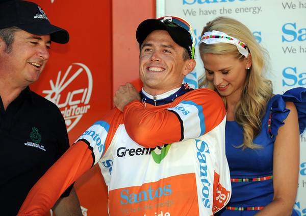 Phew! A relieved Simon Gerrans puts on the race-leader's jersey for Green Edge...